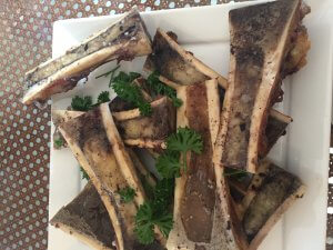Roasted beef marrow.  Not the best looking thing on the table but they are irresistible
